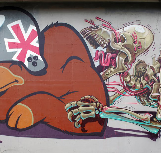 Street art:: The anatomy of mother bear giving birth
