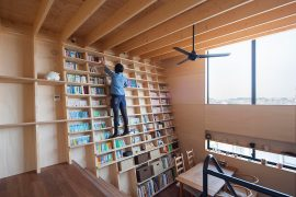 House in Yokohama with Inclined Bookcase Wall by Shinsuke Fujii Architects