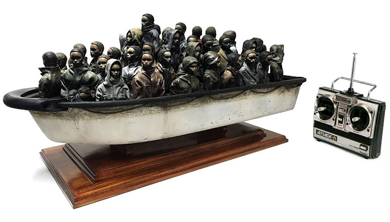 "Banksy is Raffling a Refugee Boat Sculpture from ""Dismaland"" for Only £2"